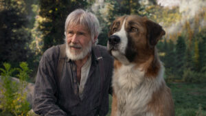 Man with beard and large dog in Alaskan wilderness